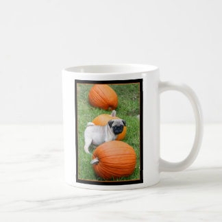 Pug puppy in pumpkins mug