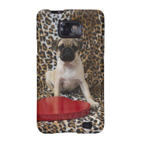 Pug puppy sitting against animal print galaxy s2 case