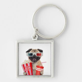 Pug watching a movie keychain