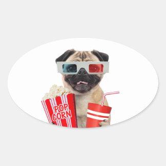 Pug watching a movie oval sticker