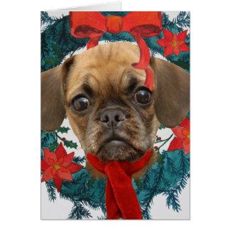 Puggle en guirnalda del navidad felicitación