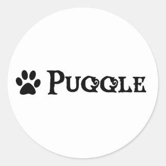 Puggle (estilo del pirata con el pawprint) pegatina redonda