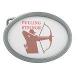 Pulling Strings Oval Belt Buckles