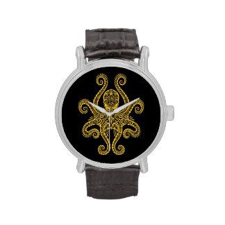 Pulpo amarillo complejo en negro relojes de pulsera