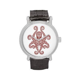 Pulpo rojo complejo en blanco reloj de mano