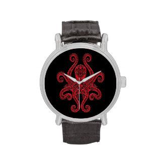 Pulpo rojo complejo en negro reloj de mano