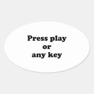 Pulse el juego o cualquier tecla pegatina ovalada