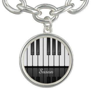 Pulsera con dije musical del diseño del teclado