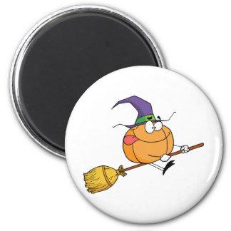 Pumkin riding a broom 2 inch round magnet