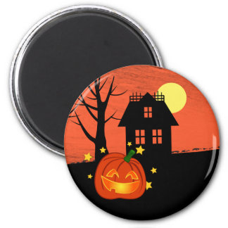 Pumpkin and haunted house 2 inch round magnet