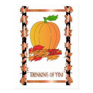 Pumpkin and russet leaves postcard