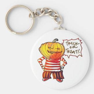 pumpkin head kid say trick or treat halloween keychain