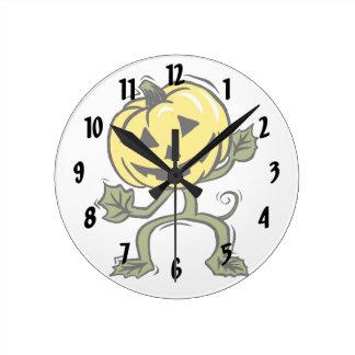 pumpkin man standing vine round wall clock
