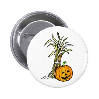 pumpkin next to corn shock graphic pinback buttons