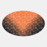Pumpkin pattern on orange black fade oval sticker
