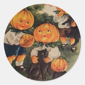 Pumpkinheads (tarjeta de Halloween del vintage) Etiquetas Redondas
