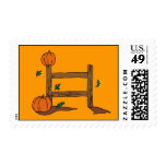 Pumpkins and fence postage stamps