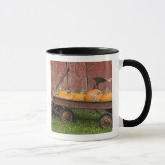 Pumpkins in old wagon mug