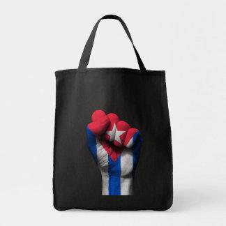 Puño apretado aumentado con la bandera cubana bolsa tela para la compra