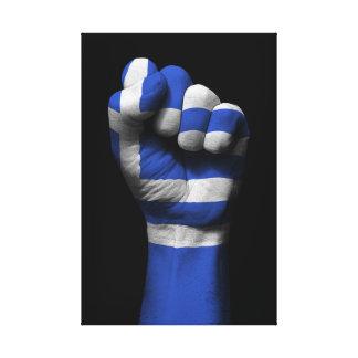 Puño apretado aumentado con la bandera griega impresión en lona