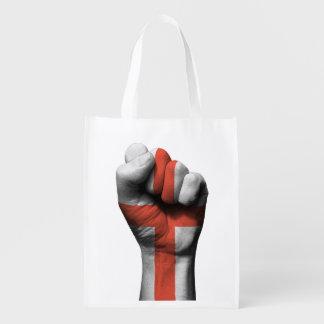 Puño apretado aumentado con la bandera inglesa bolsa reutilizable