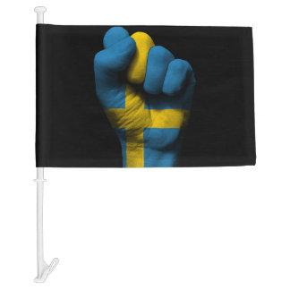 Puño apretado aumentado con la bandera sueca