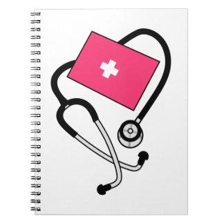 Puño de la presión arterial cuaderno