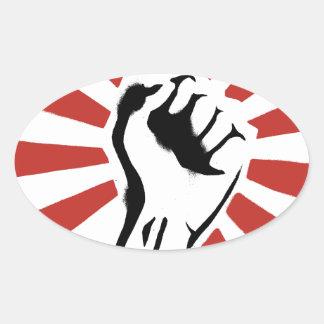 Puño de la revolución pegatina ovalada