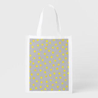 Puntos amarillos y grises del confeti bolsas de la compra