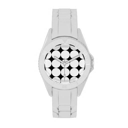 Puntos blancos en negro relojes