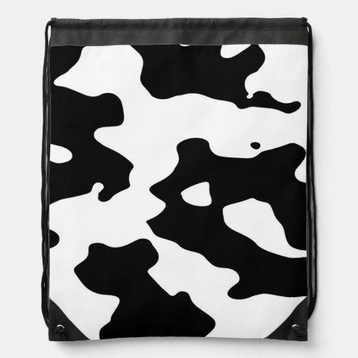 Puntos blancos y negros del modelo de la vaca mochila