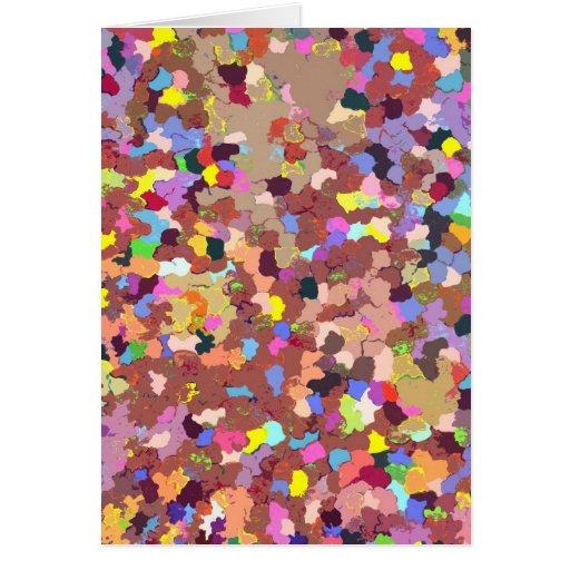Puntos coloreados que pintan la tarjeta de