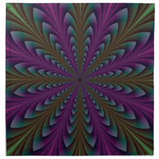 Puntos de la lanza en servilletas púrpuras y verde