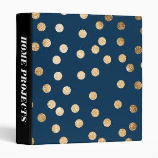 Puntos del brillo del oro en carpeta de los azules