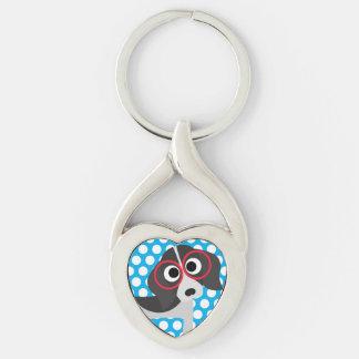 Puntos grandes en llavero azul del perro llavero plateado en forma de corazón