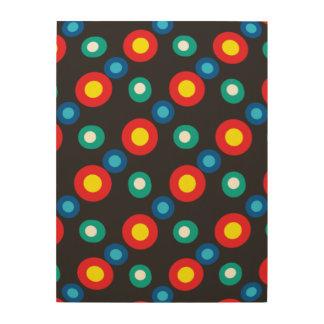 Puntos multicolores del disco impresiones en madera