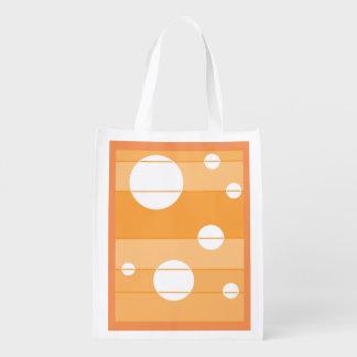 Puntos y rayas en amarillo-naranja bolsa reutilizable