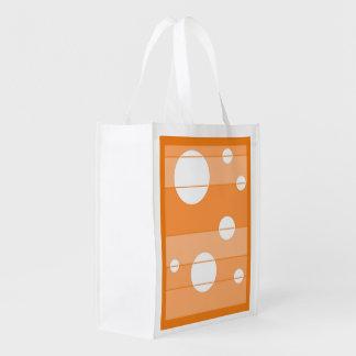 Puntos y rayas en naranja bolsas reutilizables