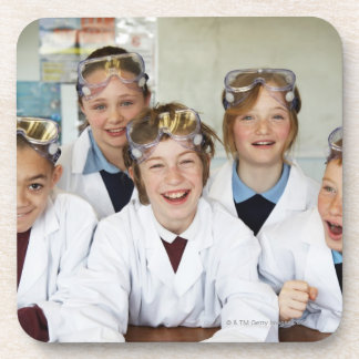 Pupils (9-12) in science class, smiling, beverage coaster