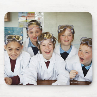 Pupils (9-12) in science class, smiling, mouse pad