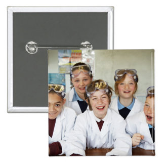Pupils (9-12) in science class, smiling, pinback button