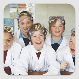 Pupils (9-12) in science class, smiling, square sticker
