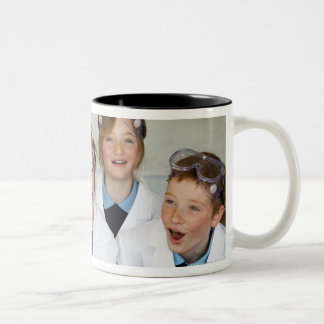 Pupils (9-12) in science class, smiling, Two-Tone coffee mug
