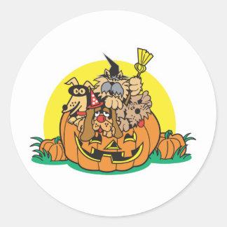 puppies in a pumpkin classic round sticker