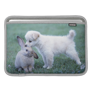 Puppy and Lop Ear Rabbit on lawn MacBook Sleeve