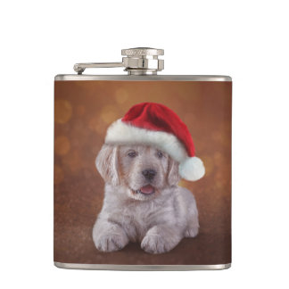 Puppy Golden Retriever in red hat of Santa Claus Flask