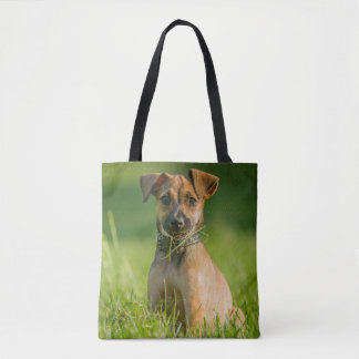 Puppy In The Grass Tote Bag