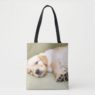 Puppy Lying Down On Sofa Tote Bag