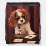 Puppy plays with cards on coffee table. drawstring bag