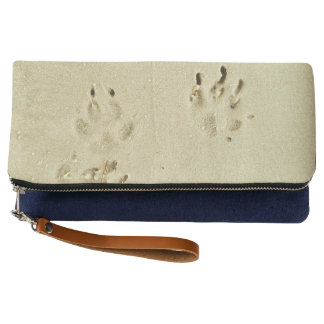 Puppy prints in the sand clutch